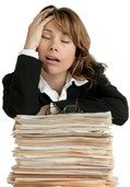 Exhausted woman on files