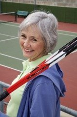 Smiling senior playing tennis