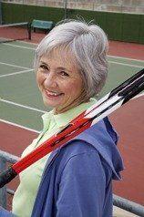 Smiling senior playing tennis